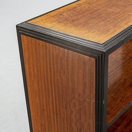 A 1940s art deco mahogany shelf.