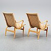 A pair of 'eva' easy chairs by bruno mathsson for firma karl mathsson, dated 1974.