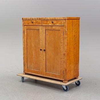 A birch veneered cupboard, early 20th century.