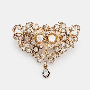 A silver brooch set with old-cut diamonds.
