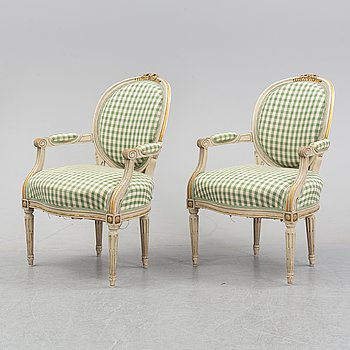A pair of Louis XVI style armchairs from around the year 1900.