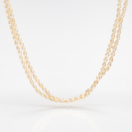A two-strand pearl collier with cultured pearls and 14k gold clasp.
