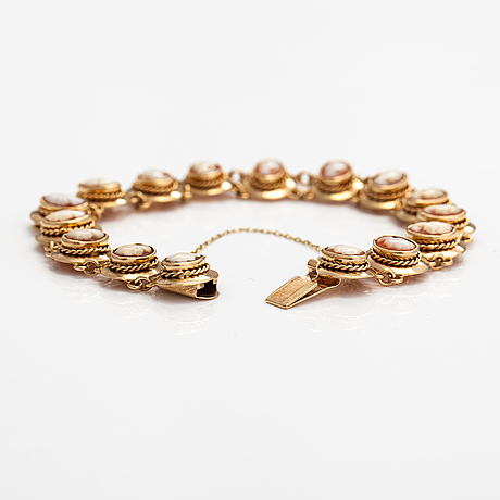 A bracelet and a necklace made of 14k gold with sea shell cameos.