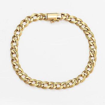 An 18K gold bracelet. Import markde Tillander, Helsinki.