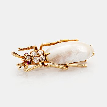 400. A Russian beetle brooch in 14K gold and silver set with a pearl and old- and rose-cut diamonds and rubies.