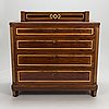 A 20th century russian chest of drawers in directoire style.