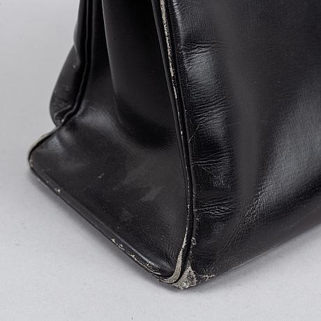 Hermès, a black leather 'kelly' handbag.