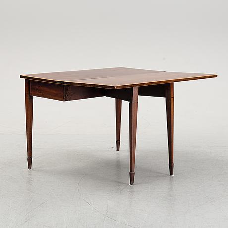 A mid 19th century mahogany card table.