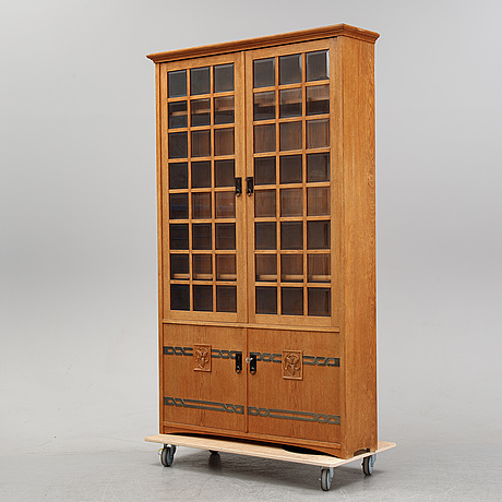 An oak vitrine cabinet, early 20th century.
