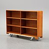 A mid 20th century elm wood book case.