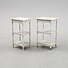 Two matching bedside tables with marble tops.
