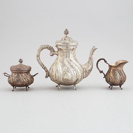 A rococo-style silver coffee pot, creamer, sugar bowl and tray. germany, swedish import mark.