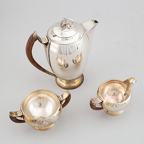 A swedish silver coffee pot, creamer and sugar bowl, mark of nordisk silverkonst, helsingborg 1948.
