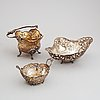 Three silver baskets, a creamer and a sugar box. some with swedish import marks.