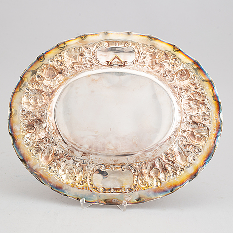 A baroque style platter by cg hallberg, stockholm 1944.
