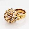 A wa bolin ring in 18k gold set with round brilliant-cut diamonds.