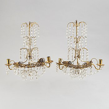 A pair of brass wall sconces, first half of the 20th century.