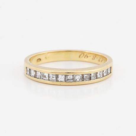 Step-cut diamond ring.
