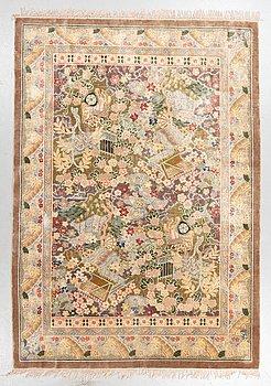 A carpet, Old silk China, ca 242 x 170 cm.