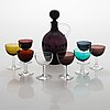 Saara hopea, a glass carafe and eight liqueur glasses, nuutajärvi, finland. models designed in 1959 and 1953.