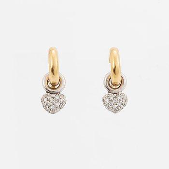 18K gold hoop and heart shaped brilliant-cut diamond earrings.