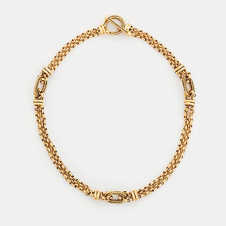 An 18k gold necklace retailed by wa bolin.