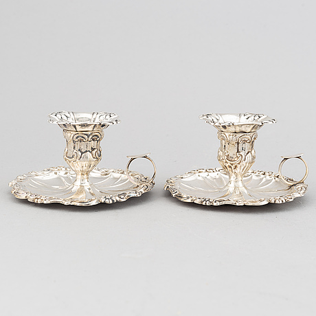 A pair of swedish silver chamber candlesticks, mark of johan edvard holm, kristianstad 1849.