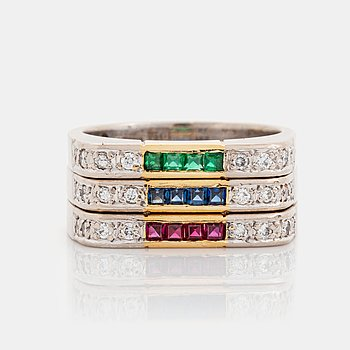 377. Gaudy rings in 18K gold set with step-cut rubies, emeralds and sapphires.