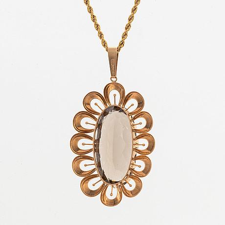 Oval mixed cut smoky quartz necklace.
