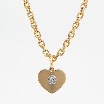 18K gold heart pendant with chain.