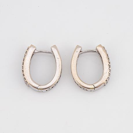 Small brilliant-cut diamond earrings.