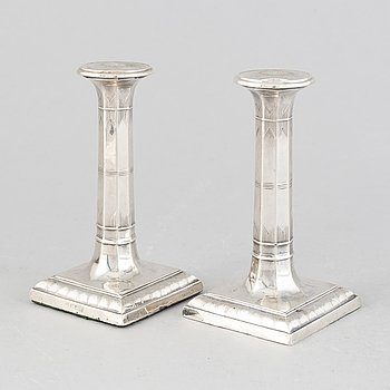 A pair of silver candlesticks, mark of Thomas Bradbury & Sons Ltd, Sheffield 1918.