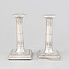 A pair of silver candlesticks, mark of thomas bradbury & sons ltd, sheffield 1918.
