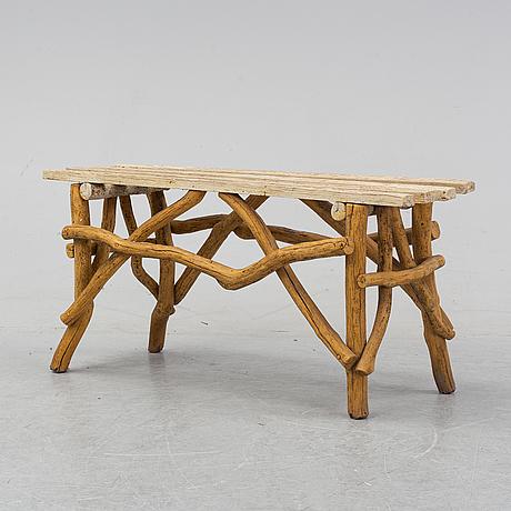 A wooden garden bench, 20th century.