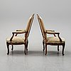 A pair of louis xv style armchairs from early 20th century.