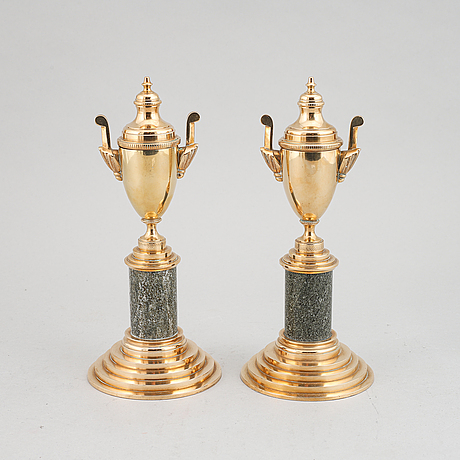 A pair of brass and marble candle holders/casslettes from skultuna, 20th century.