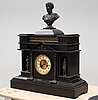 A late 19th century stone mantle clock.