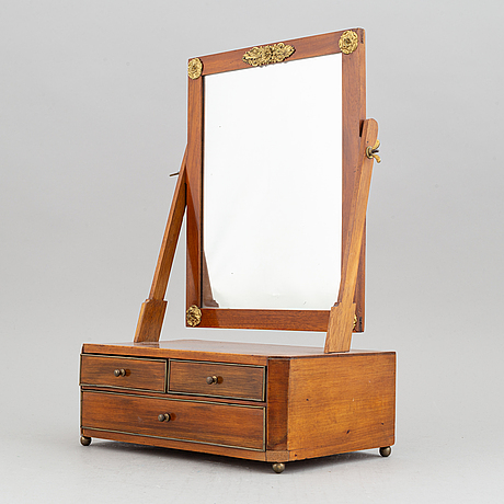 An empire table mirror, first half of the 19th century.