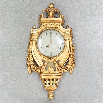 A Gustavian pendulum wall clock.