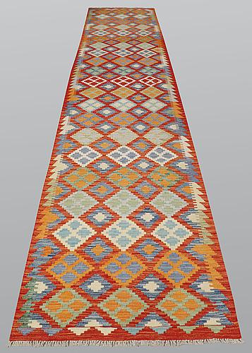A runner, kilim, ca 486 x 85 cm.