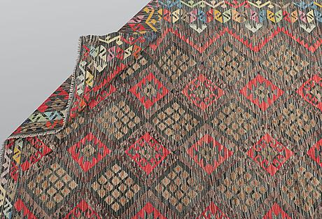 A carpet, kilim, ca 250 x 220 cm.