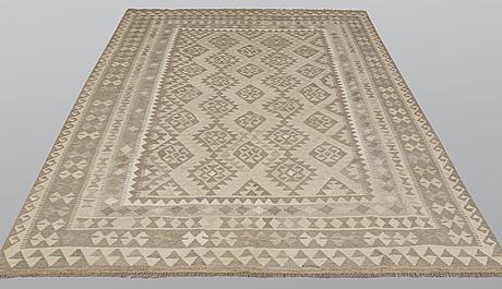 A carpet, kilim, ca 303 x 203 cm.