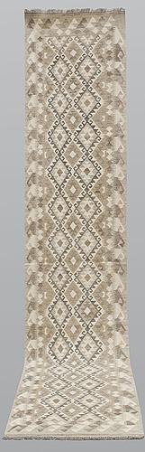 A runner, kilim, ca 394 x 79 cm.