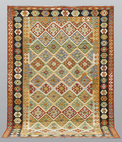 A carpet, kilim, ca 301 x 215 cm.