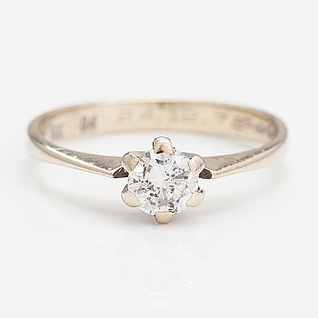 A 14K gold ring with a ca. 0.40 ct diamond. Finnish import marks 1978.