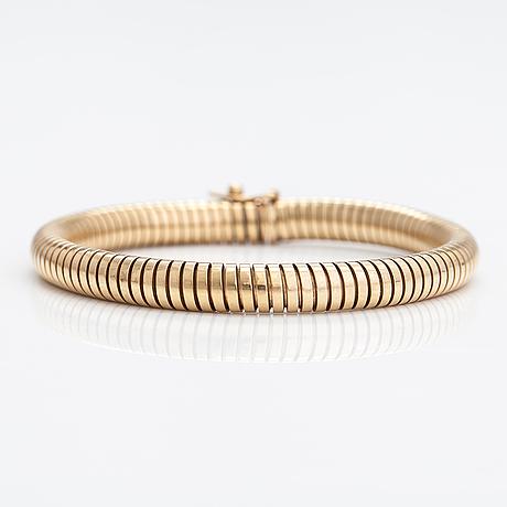 A pair of 9k gold earrings and a 9k gold bracelet. birmingham 1995.
