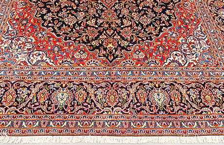 A carpet, kashan signed, ca 482 x 305 cm.