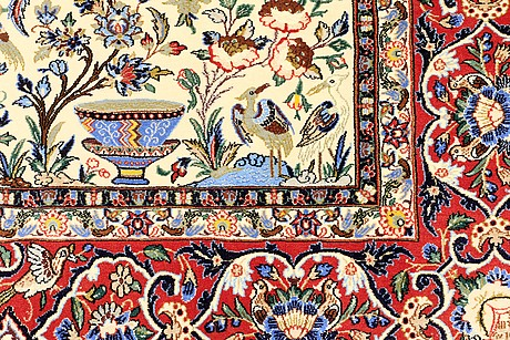 A rug, figural esfahan, part silk, ca 240 x 160.