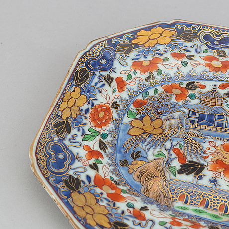 A blue and white 'clobbered' serving dish, qing dynasty, qianlong (1736-95).