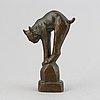 Jussi mäntynen, a patinated bronze sculpture of a lynx, signed.